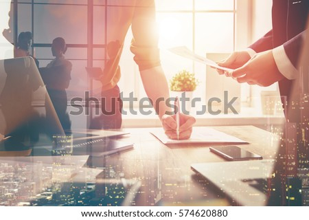 man and woman working in the office. collaborative teamwork. Royalty-Free Stock Photo #574620880