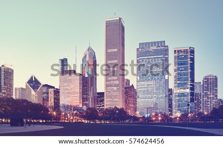 Retro stylized picture of Chicago downtown at twilight, USA.