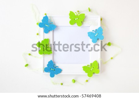 Square white blank photo frame with butterflies