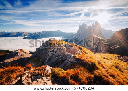 Aerial view of the alpine valley in sunlight. Great and gorgeous morning scene. Location place Puez-Odle National Park, Gardena, Seceda peak, Geisler Dolomiti group. Tyrol, Italy, Europe. Beauty world #574708294