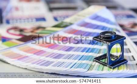 Color management in printing process with magnifying glass and color swatches #574741411
