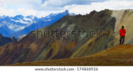 Explorer in pristine rugged wilderness, Talkeetna Mountains, Alaska #574868926