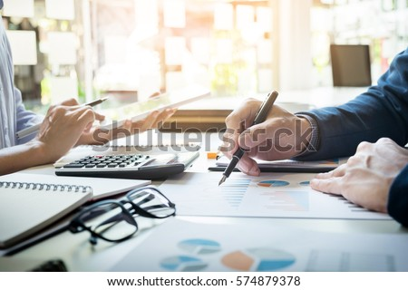 Administrator business man financial inspector and secretary making report, calculating balance. Internal Revenue Service checking document. Audit concept Royalty-Free Stock Photo #574879378