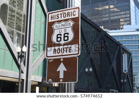 CHICAGO, ILLINOIS - FEBRUARY 5: Sign informs drivers of start for Route 66 historic roadway route on February 5, 2017 next to Amtrak Union Station in West Loop.  #574974652