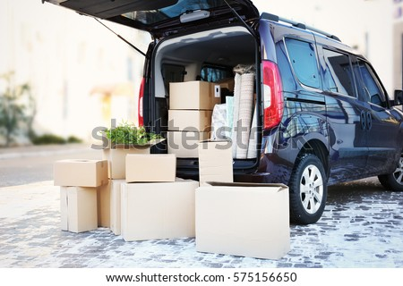 House moving concept. Cartoon boxes in a car trunk