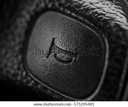 Car horn sign on a steering wheel Royalty-Free Stock Photo #575295481
