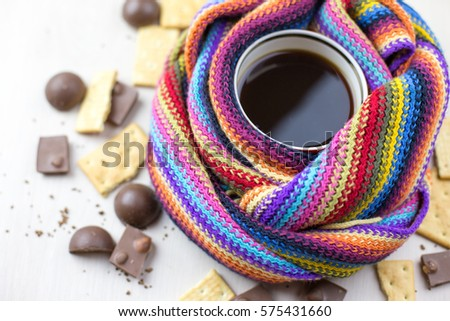 hot coffee scarf candy cookie white background #575431660