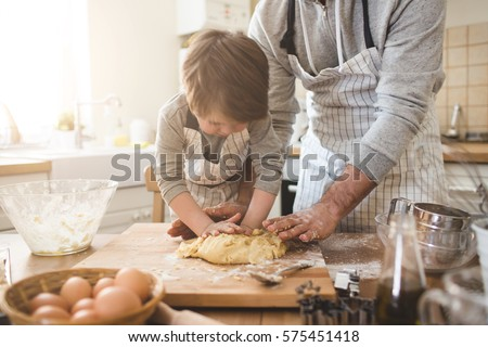A father and his son cooking #575451418