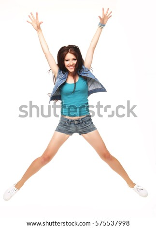 Full length portrait of a cheerful woman jumping  on a white bac #575537998