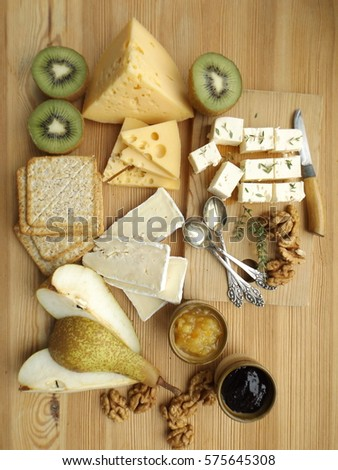 Cheese board with fruit and two kinds of jam #575645308