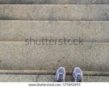 White shoes standing on the steps staircase exercise in park #575842693