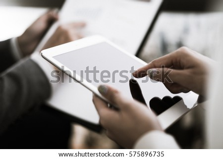 Business adviser analyzing financial figures denoting the progress in the work of the company #575896735