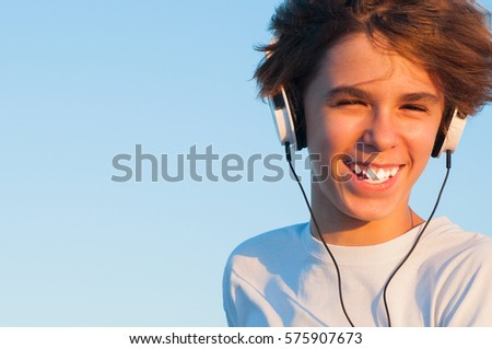 Smiling Cool Boy Listening to Music #575907673