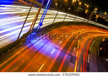 Traffic at city highway at evening, light effects, Austria, Vienna, traffic, Vienna South-East-Highway #576109402