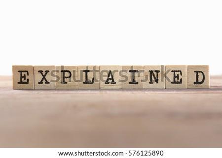 Explained Word Written In Wooden Cube
