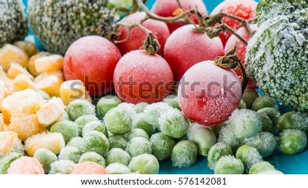 frozen vegetables: broccoli, cherry tomatoes, corn, pea, carrot  Royalty-Free Stock Photo #576142081