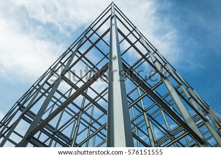 Structure of steel  for building construction on sky background. Royalty-Free Stock Photo #576151555