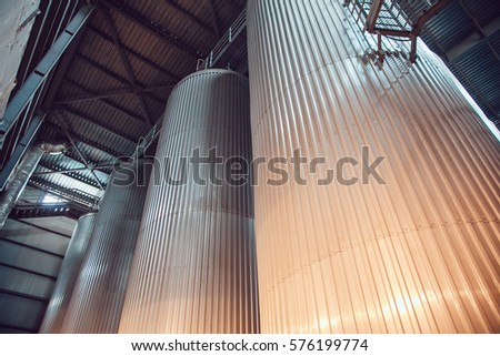 Modern beer plant, with brewing kettles, vessels, tubs and pipes made of stainless steel. Brewery. #576199774