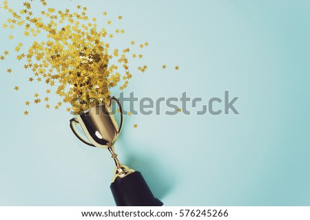 image of little  gold cup , concept for winning or success Royalty-Free Stock Photo #576245266