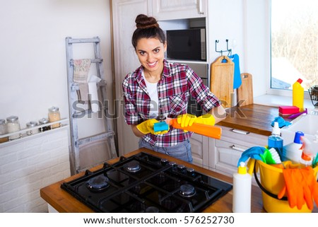 Beautiful young woman makes cleaning the house. Girl cleaning kitchen. Set. #576252730