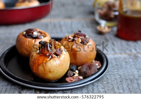 baked apples with honey and pecan #576322795