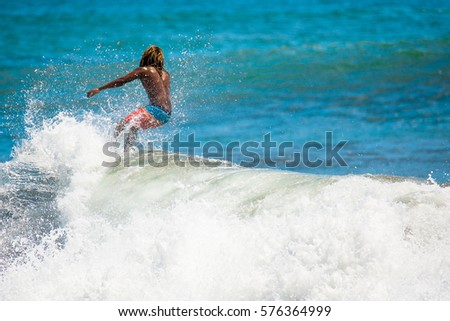 Riding the waves. Costa Rica, surf paradise #576364999