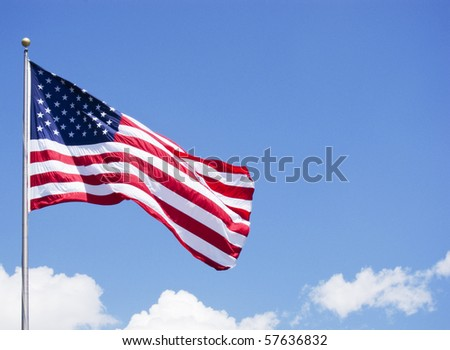 photo of a American flag on a post with cloudy background