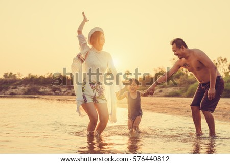 Family playing on the beach #576440812