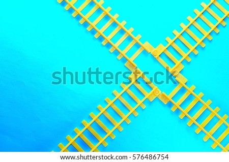 toy railway track on blue background
