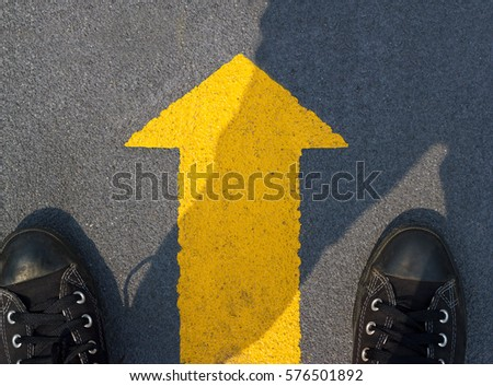 Man standing with yellow arrow move forward for the future, Top view #576501892