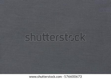 Close up of dark fabric texture. Clothes background. Hi res