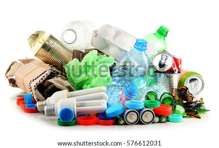 Recyclable garbage consisting of glass, plastic, metal and paper isolated on white Royalty-Free Stock Photo #576612031