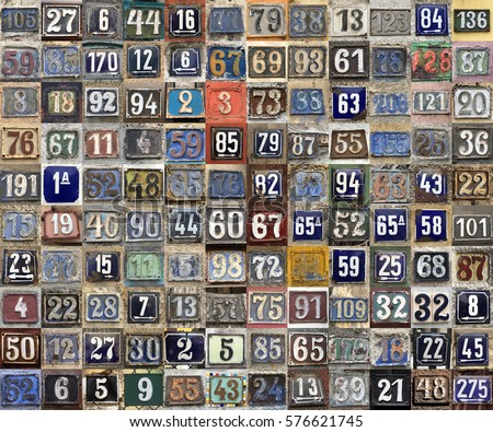 Vintage grunge square metal rusty plate of numbers of street address with numbers closeup