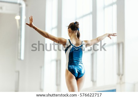 competition gymnastics balance beam exercises to back girl gymnasts