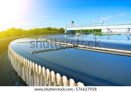 Modern urban wastewater treatment plant. Royalty-Free Stock Photo #576627958