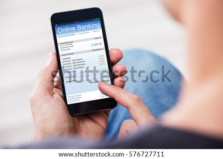 Close-up Of A Man Using Online Banking On Mobile Phone #576727711