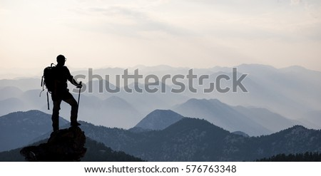 alone at the summit climber & successful climbers Royalty-Free Stock Photo #576763348