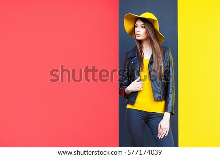 Beautiful young woman in yellow hat Royalty-Free Stock Photo #577174039