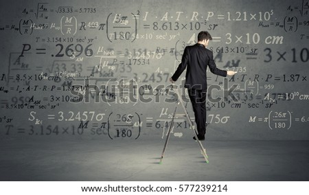 A businessman in modern stylish elegant suit standing on a small ladder and drawing pie and block charts on grey wall background with exponential progressing curves, lines, circles,  blocks, numbers #577239214