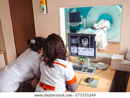 MRI machine and screens with doctor and nurse #577255249