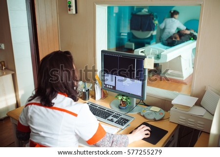 MRI machine and screens with doctor and nurse #577255279