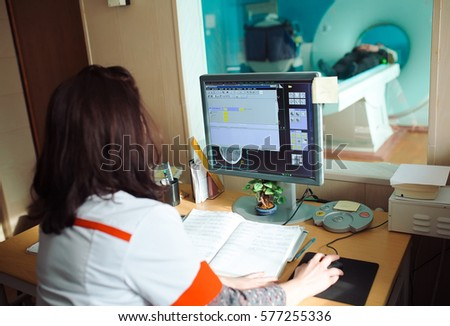 MRI machine and screens with doctor and nurse #577255336
