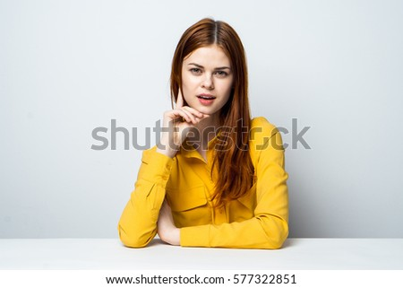 Beauty woman behind the white table, isolated background #577322851