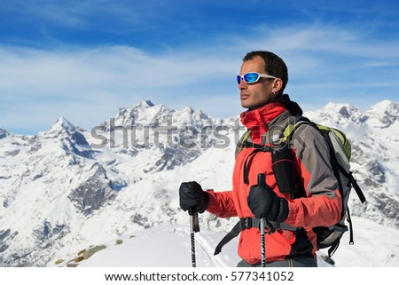 Man mountain winter clothes. Ski touring in italian Alps, Gran Paradiso National Park #577341052