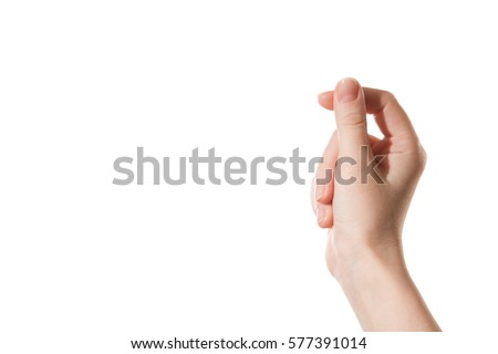 Female hand holding a virtual card with your fingers on a white background Royalty-Free Stock Photo #577391014