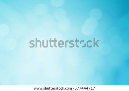 abstract blurred flash aura of blue background with bokeh flare light.