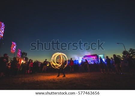 Fire show on music festival. Royalty-Free Stock Photo #577463656