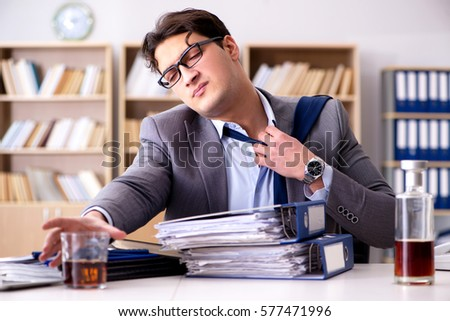 Young businessman drinking from stress #577471996