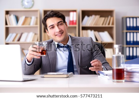 Young businessman drinking from stress #577473211