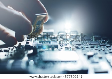Electronic engineer of computer technology. Maintenance computer cpu hardware upgrade of motherboard component. Pc repair, technician and industry support concept. #577502149
